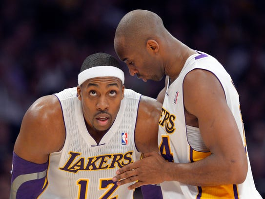 Kobe Bryant chats with Dwight Howard during the first