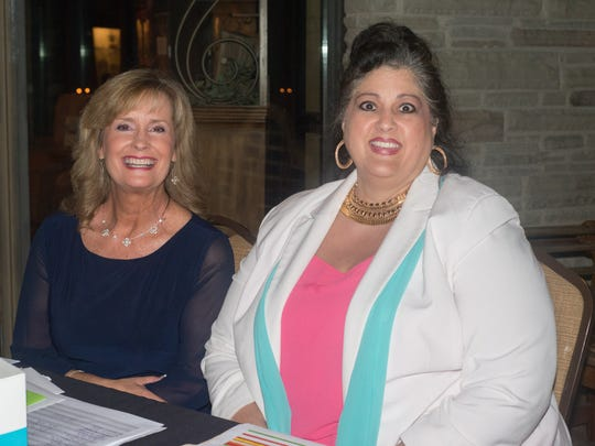 Karen Mitchell and Dana Given are all smiles during