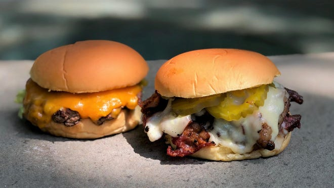 The Goyim burger, right, comes with both bacon and pastrami.