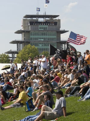 Fans watch 2008 MotoGP action from the spectator mounds at Indianapolis Motor Speedway.