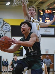 Damonte's Javin Basabas goes up to shoot with Galena's