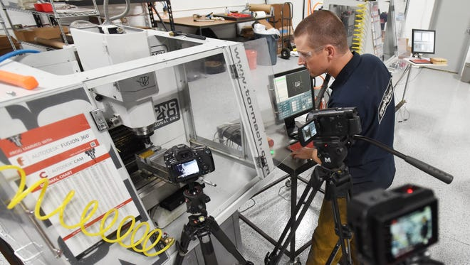 John Saunders of Saunders Machine Works gets ready to film at his shop in Zanesville. The company has several CNC machines, as well as a training program and popular YouTube channel.