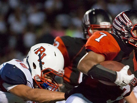 Red Land's Phil Overton is unable to bring down Dover's Durran Ledbetter  Friday, Sept. 12, 2014.     JOHN WHITEHEAD for the Daily Record/Sunday News