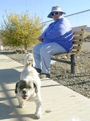 Mary Ellen Gallagher brings her Shih Tzus Max and Winston