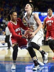 East Nashville's Kaia Upton (14) strips the ball in the paint from Abby Greenwood (23) in the Division I Class AA Girl's basketball finals at the Murphy Center on MTSU's campus March 12, 2016 in Murfreesboro, Tenn.