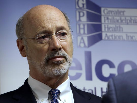 FILE - In this May 8, 2018 file photo, Pennsylvania Gov. Tom Wolf listens to state Rep. Jordan Harris (D-Phila.) during a news conference in Philadelphia. The politics of abortion could be especially prominent in the fall as Wolf and Republican Scott Wagner hit the final stretch of Pennsylvania's gubernatorial campaign. (AP Photo/Jacqueline Larma, File)