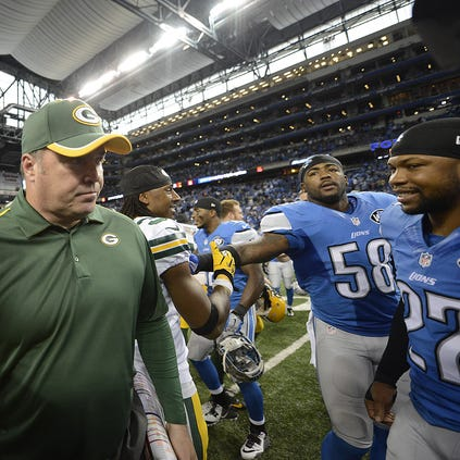 Green Bay Packers head coach Mike McCarthy walks off the field after Sunday's game against the Detroit Lions at Ford Field in Detroit.