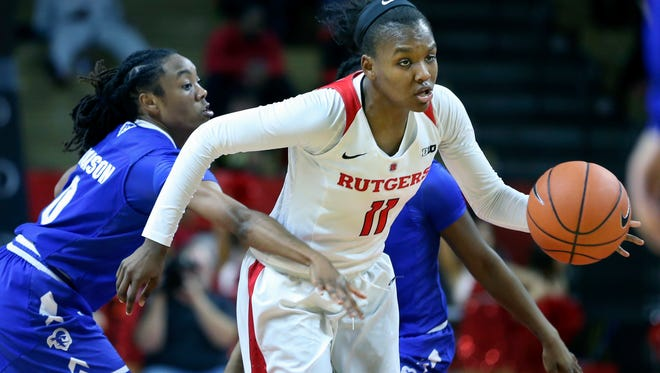 Rutgers guard Aliyah Jeune (11)dribbles the ball away as Seton Hall guard JaQuan Jackson (0) can't make a steal during the second half of an NCAA college basketball game Tuesday, Dec. 13, 2016, in Piscataway, N.J. Rutgers won 53-45. (AP Photo/Mel Evans)
