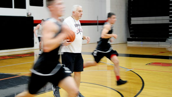 North Buncombe basketball coach Chuck Robinson watches his team during practice Nov. 24.