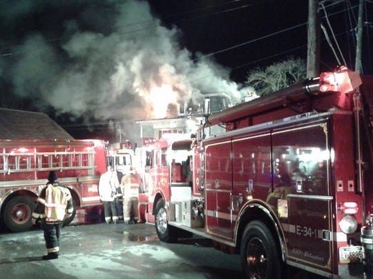 Smoke pours from the Kleinfeltersville Hotel as fire