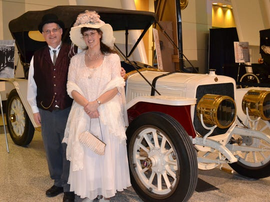 Jay and Barbara Follis stand next to a 1910 Lozier at the Gilmore Car Museum. They dress in period clothes and discuss Michigan ties to the Titanic sinking. Survivors Dickinson and Helen Bishop of Dowagiac owned a similar Lozier.