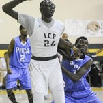 Craig Bailey/FLORIDA TODAYTacko Fall fights for position against Usman Harumns of The Potter's House during a recent game. Tacko Fall fights for position against Usman Harumns of The Potter's House during a recent game.