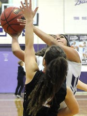 Milia Picotte gets blocked on a two-pointer.