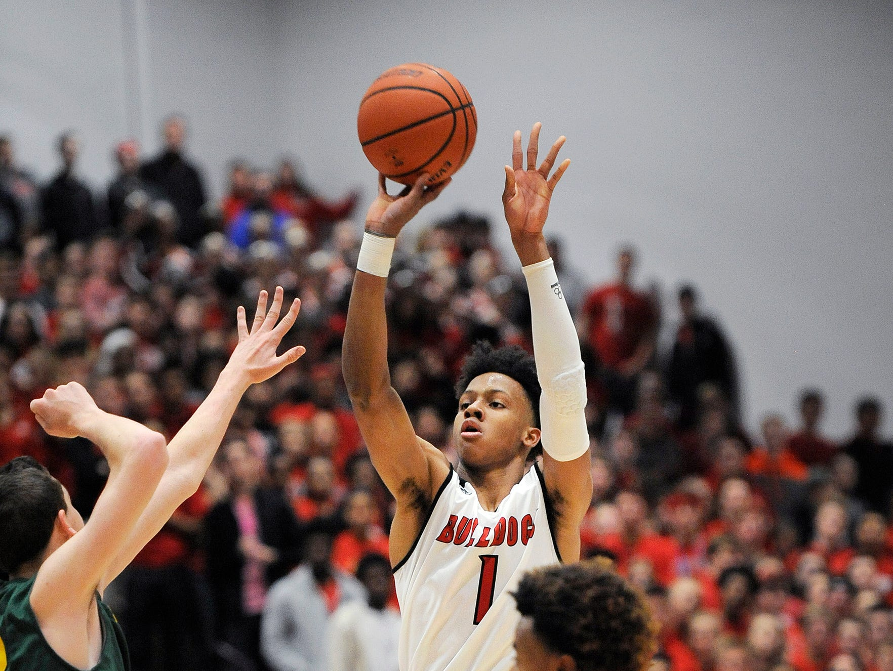 New Albany's Romeo Langford (1) shoots a three pointer against Floyd Central on Friday at New Albany High School. (Photo by David Lee Hartlage, Special to The Courier-Journal) Dec. 9, 2016