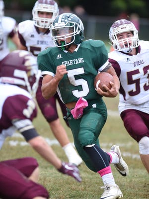 Spackenkill's Camron Abalos, center, works his way through O'Neill's defense as Kevin Shepherd makes a grab for him during Saturday's game at Spackenkill.