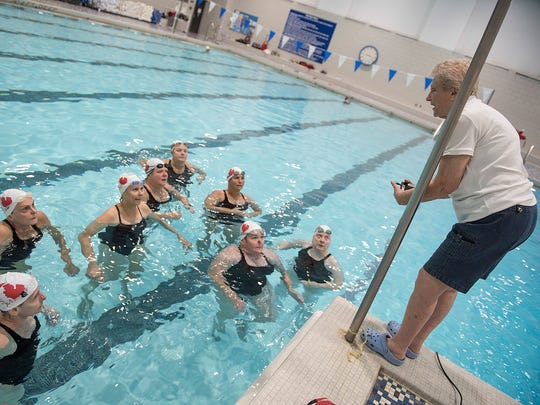 Michigan Synchro Masters coach Joyce Lindeman offers a critique to the team.