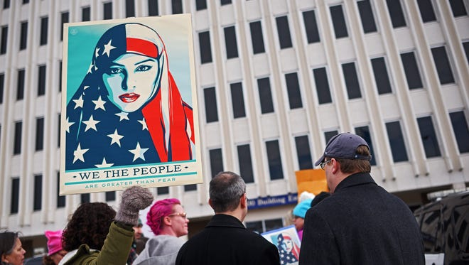 Demonstrators protest against President Donald Trump's executive order suspending the U.S. refugee program for 120 days and banning all immigrants from seven Muslim-majority countries Tuesday, Jan. 31, 2017, in Sioux Falls. The Senate State Affairs Committee on Wednesday, February 21 are set to weigh a proposal giving lawmakers veto power over refugee resettlement in South Dakota.