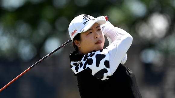 Shanshan Feng of China tees off to begin the final round of the U.S. Women's Open at Trump National Golf Club in Bedminster, NJ on Sunday, July 16, 2017.