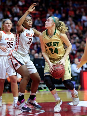 Iowa City West's Emma Koch drives to the hoop in the 5A state semifinal game against West Des Moines Valley March 3, 2017.