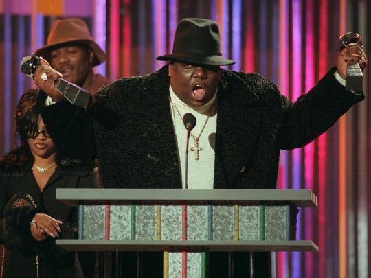 FILE--Notorious B.I.G., winner of rap artist and rap single of the year, clutches his awards at the podium during the annual Billboard Music Awards in New York Wednesday evening, Dec. 6, 1995. The rapper, whose real name was Christopher Wallace, was gunned down in Los Angeles as he left a party early Sunday, March 9, 1997, police said. Wallace, 24, was reportedly attending a party at the Petersen Automotive Museum in celebration of Friday s 11th Annual Soul Train Music Awards. (AP Photo/Mark Lennihan, File) ORG XMIT: NY107