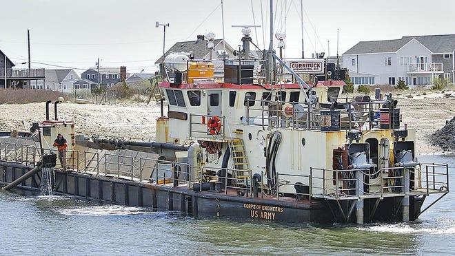 The U.S. Army Corps of Engineers barge Currituck clears sand and mud from the Green Harbor channel on May 7, 2019.