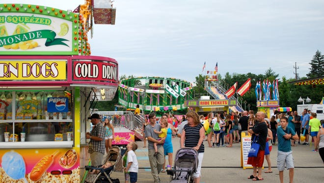 Crowds fill the midway to enjoy rides at Greater Anderson Days.