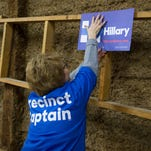 A Hillary Clinton precinct captain hangs a poster at a Democratic Party caucus at Jackson Township Fire Station on Feb. 1, 2016, in Keokuk, Iowa.