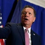 Republican presidential candidate, Ohio Gov. John Kasich eats pizza at Gino's Pizzeria, Wednesday, March 30, 2016, in the Queens borough of New York. The three Republican presidential candidates now say they aren't committing to supporting whomever the party chooses as its nominee for the November election, which could lead to a messy and fractured nominating convention in July. (AP Photo/Mark Lennihan)