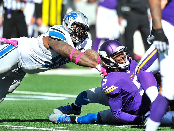 Lions defensive tackle C.J. Mosley and safety James