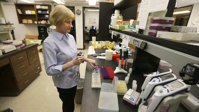 Jean Bidlack at work in her lab at the University of Rochester Tuesday, Feb. 20, 2018.