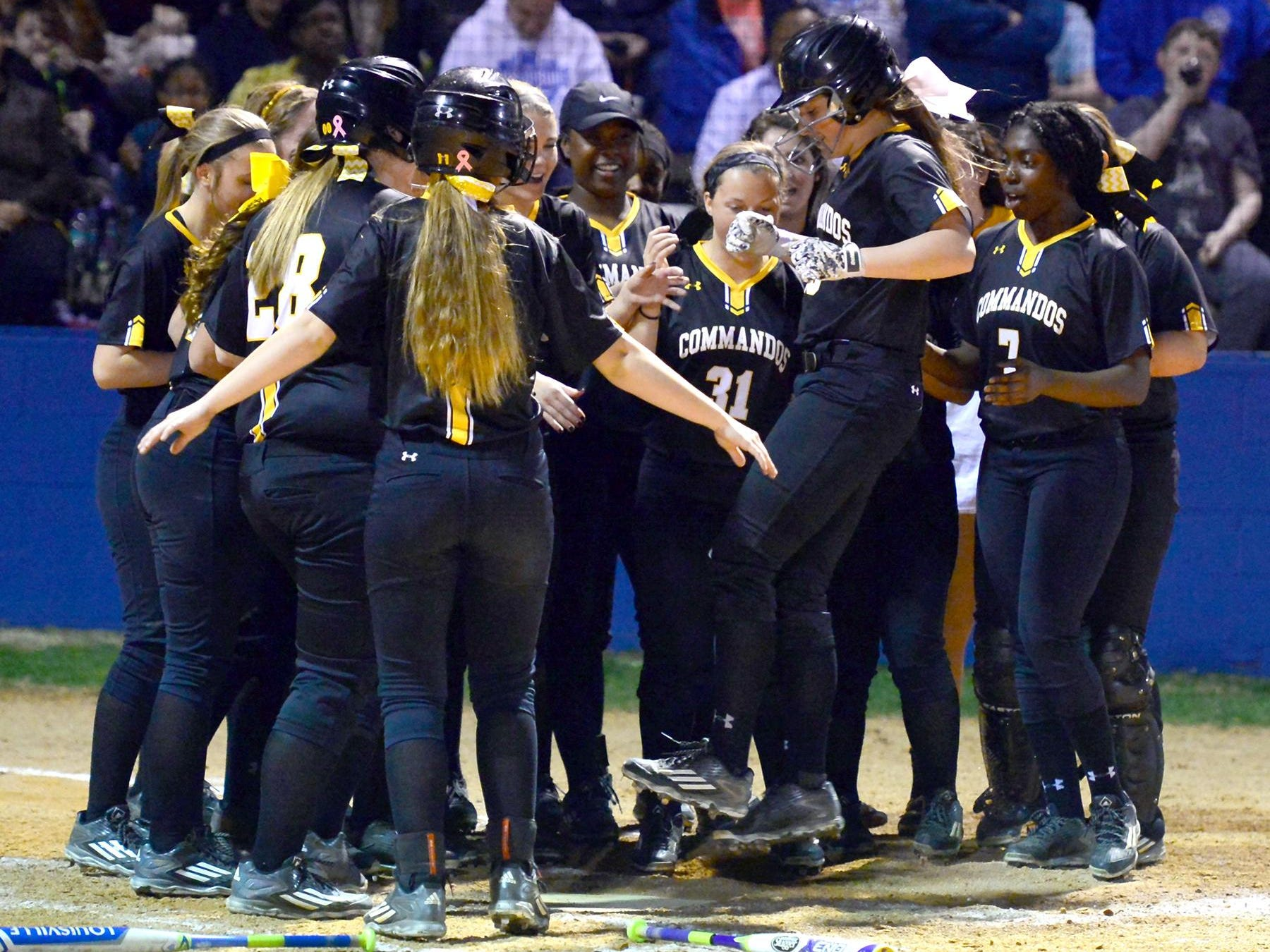Teammates greet Hendersonville High junior Matti Byrd at home plate after her home run during third-inning action against White House Heritage.
