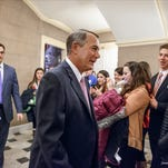 House Speaker John Boehner encounters a student tour group outside his office on Capitol Hill Tuesday, as the House votes on funding for the Homeland Security Department without provisions attached to counter President Barack Obama's executive actions on immigration.