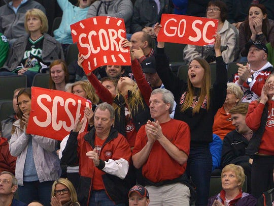 St. Cloud State supporters celebrate Jacob Benson's goal during the third period of the NCAA Division 1 West Regional semifinal game Saturday, March 25, at the Xcel Energy Center in St. Paul. Ferris State's 5-4 victory over St. Cloud State in overtime ends the Huskies' run for title.
