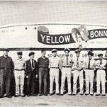 Springfield Grocer Co. moved from just delivering groceries to selling its own brand: Yellow Bonnet Coffee, which was popular for decades. This was the delivery fleet.