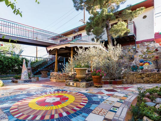 "Walk the new bridge over his ""magic courtyard"" to Hal Marcus' garage studio behind his house in Sunset Heights. The studio will be open to the public from noon to 5 p.m. today."