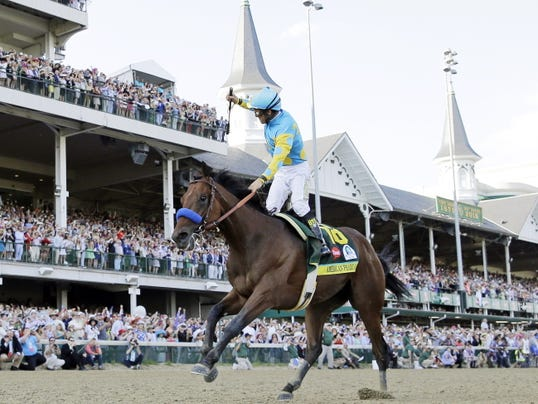 In this May 2, 2015 file photo, jockey Victor Espinoza celebrates aboard American Pharoah after winning the 141st running of the Kentucky Derby horse race at Churchill Downs in Louisville, Ky.