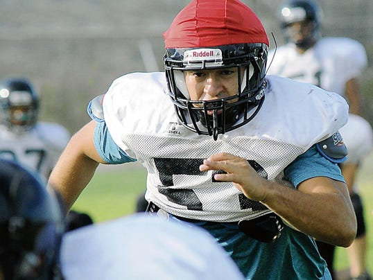 Robin Zielinski - Sun-News   Oñate HIgh School's Luis Duarte looks to make a tackle on Friday during practice.