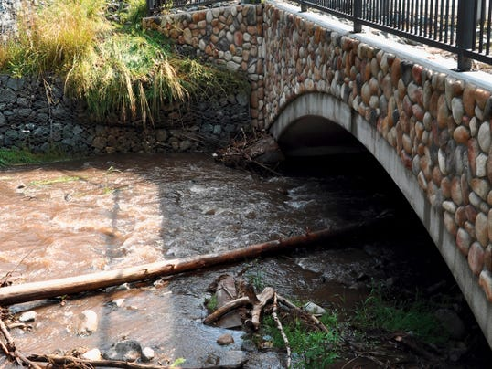 Michelle Huey — Ruidoso News Intense rainfall in Ruidoso has stream water levels right at or below the tops of banks. Officials say debris causes the biggest problems with water flow.