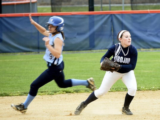 Daniel Boone's Sydney Hayes, left, runs to third base as shortstop Ciara Glunt of Chambersburg fields a ball on Thursday. The Lady Trojans lost 5-0 in the District 3 Class AAAA quarterfinals.