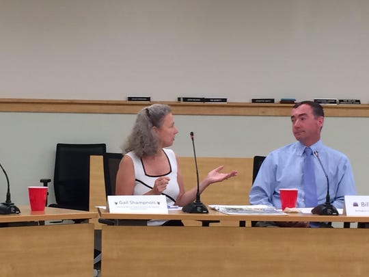 Gail Shampnois, director of the Office of Student and Community Relations, talks to Bill Ward, Burlington's code enforcement officer, at a noise forum hosted by the City of South Burlington on Thursday. The pair was invited to discuss how UVM and Burlington deal with excessive noise from student renters.