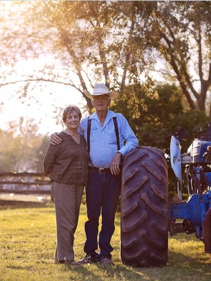 Barbara and Clif McDonald stand near their ranch just outside of Alamogordo.