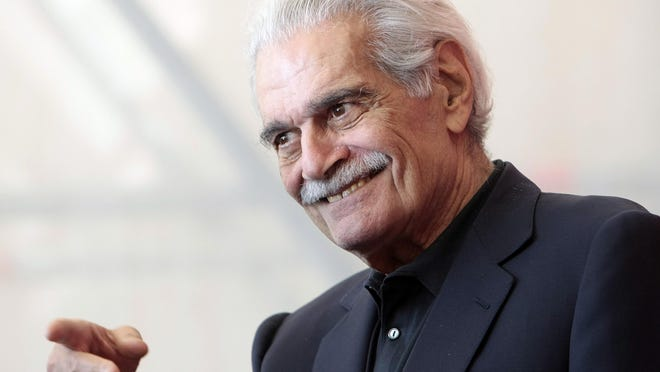 FILE - In this Thursday, Sept. 10, 2009 file photo, Egyptian actor Omar Sharif gestures during the photo call for the film 'Al Mosafer (The Traveller)' at the 66th edition of the Venice Film Festival in Venice, Italy. Sharif has died in a Cairo hospital of a heart attack, his agent said on Friday, July 10, 2015. (AP Photo/Andrew Medichini, File)