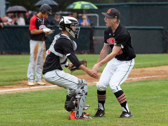 Somerville pitcher Bobby Worman celebrates with his