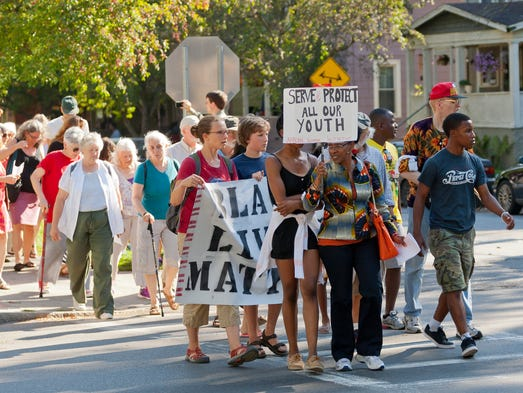 Hundreds marched from the Southside Community Center to Ithaca City Hall Wednesday to protest the treatment of youths by the Ithaca Police Department on Aug. 9.