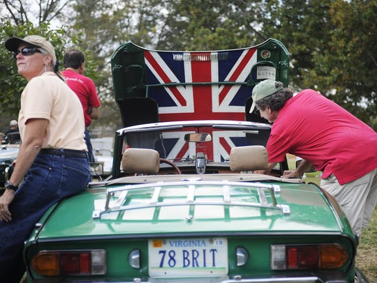Chris Porter and husband Dan with their 1978 Triumph