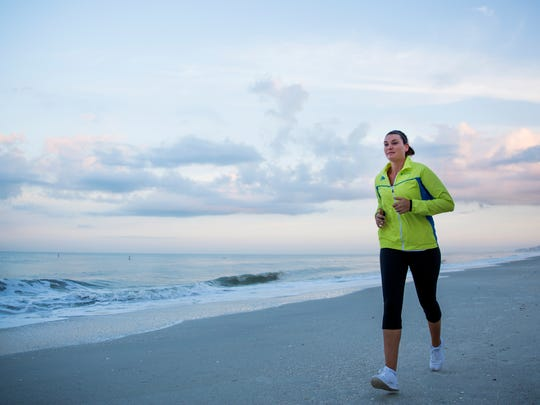 Lely teacher Danielle Normile runs up and down Bonita Beach near Doc's Beach House on Saturday, April 1, 2017 as a part of her training for the Boston Marathon. She is running on behalf of the Spaulding Race for Rehab team.
