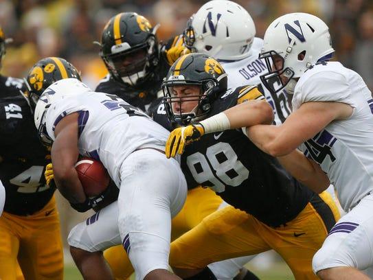 Iowa defensive end Anthony Nelson hits Northwestern