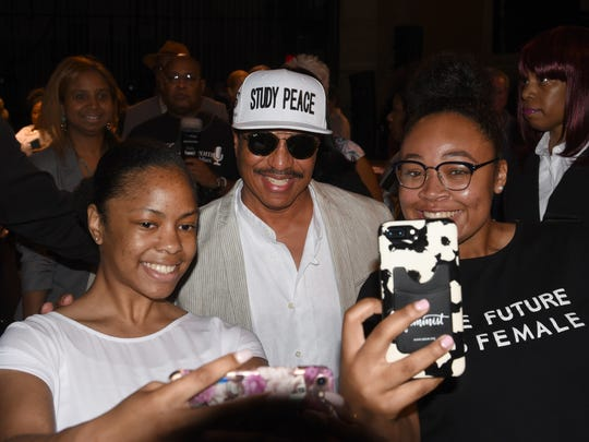 Marlon Jackson (center) poses with selfies with Kennedy Montgomery (left) and Betty Jean Bowles.