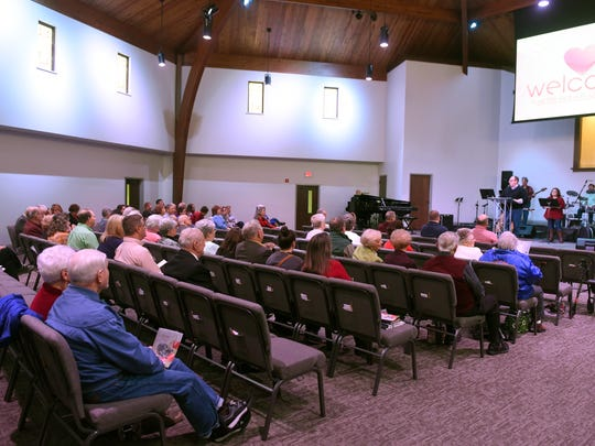 Rev., Andy Weaver welcomes church members and visitors at Grace Point Church in Henderson Sunday.  The congregations of Immanuel Baptist and Audubon Baptist churches in HendersonÊhave combined over the last year to form Grace Point Church.