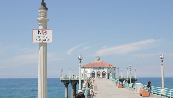 Fishing has been banned temporarily at the Manhattan Beach Pier.
